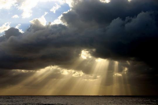 sun-rays-through-dark-clouds